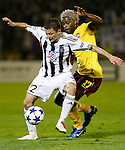 Partizan player Sasa Ilic, left in action against Arsenal player Alex Song, right,  during  UEFA Champions league match in group H FC Partizan Belgrade Vs. Arsenal, London, Serbia, Monday, Sept. 28, 2010.  (Srdjan Stevanovic/Starsportphoto.com)
