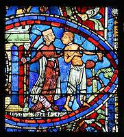 The courtesan chases the younger son away wielding a club, from the Parable of the Prodigal Son stained glass window, in the north transept of Chartres Cathedral, Eure-et-Loir, France. This window follows the parable as told by St Luke in his gospel. It is thought to have been donated by courtesans, who feature in 11 of the 30 sections. Chartres cathedral was built 1194-1250 and is a fine example of Gothic architecture. Most of its windows date from 1205-40 although a few earlier 12th century examples are also intact. It was declared a UNESCO World Heritage Site in 1979. Picture by Manuel Cohen