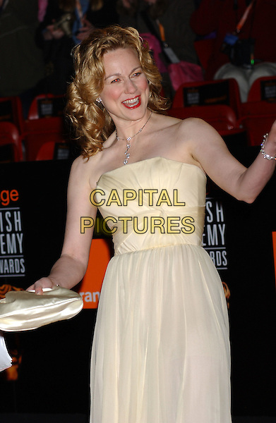 LAURA LINNEY.Bafta Awards - British Academy Awards at Odeon Leicester Square.15 February 2004.half length, half-length, funny.www.capitalpictures.com.sales@capitalpictures.com.©Capital Pictures