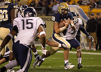 Pitt quarterback Tino Sunseri (12) scores on an 8-yard run. The Pittsburgh Panthers beat the UCONN Huskies 35-20 at Heinz field in Pittsburgh, Pennsylvania on October 26, 2011.