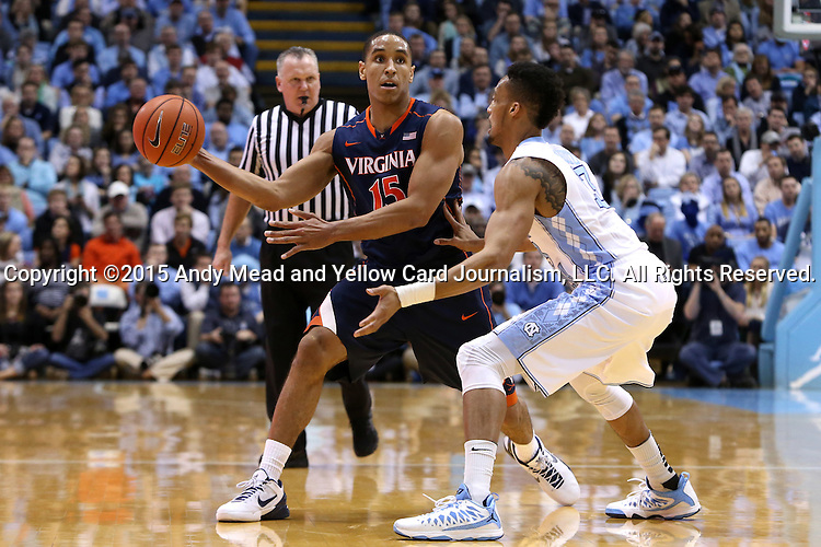 02 February 2015: Virginia's Malcolm Brogdon (15) and North Carolina's J.P. Tokoto (right). The University of North Carolina Tar Heels played the University of Virginia Cavaliers in an NCAA Division I Men's basketball game at the Dean E. Smith Center in Chapel Hill, North Carolina. Virginia won the game 75-64.