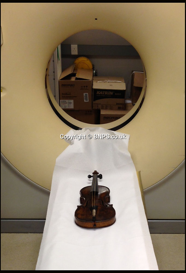 BNPS.co.uk (01202 558833)<br /> Picture: HAldridge/BNPS<br /> <br /> ****Please use full byline****<br /> <br /> The violin which had to go through a hospital CT Scanner to prove it's authenticity. <br /> <br /> The violin played by the bandmaster on the Titanic as the ship was sinking is finally being auctioned for an estimated £400,000.<br /> <br /> The wooden instrument has been proven to be the one used by Wallace Hartley as his band famously played on to help keep the passengers calm during the disaster.<br /> <br /> Its existence and survival only emerged in 2006 when the son of an amateur violinist who was gifted it by her music teacher in the early 1940s contacted an auctioneers.