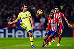 Sergio Busquets of FC Barcelona (L) controls the ball during the La Liga 2018-19 match between Atletico Madrid and FC Barcelona at Wanda Metropolitano on November 24 2018 in Madrid, Spain. Photo by Diego Souto / Power Sport Images