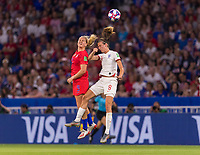 LYON,  - JULY 2: Lindsey Horan #9 goes up for a header with Jill Scott #8 during a game between England and USWNT at Stade de Lyon on July 2, 2019 in Lyon, France.