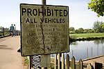 Old road sign Prohibited All Vehicles on a small bridge, Flatford, Suffolk, England