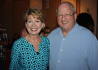NWA Democrat-Gazette/CARIN SCHOPPMEYER Robin and Gary George enjoy the Color of Hope VIP reception July 22.