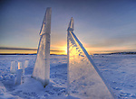 Sunrise behind ice panels on Great Slave Lake