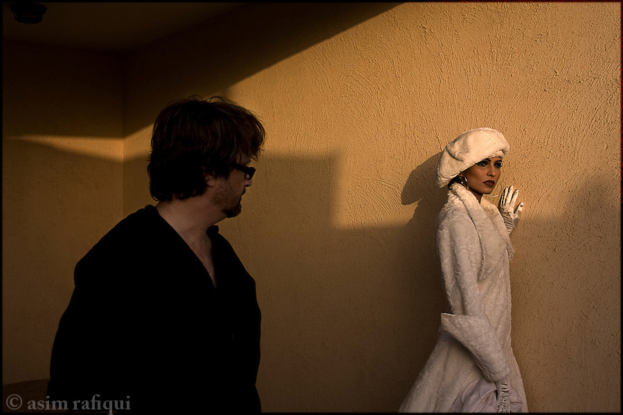 Rizwan Beyg, one of Pakistan's most successful fashion designers, directs a model wearing one of his more european designs at a fashion shoot on the outskirts of Karachi