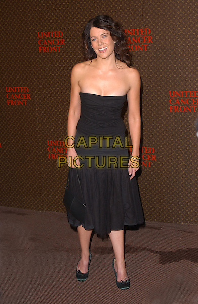LAUREN GRAHAM.The 2nd Annual Louis Vuitton United Cancer Front Gala held at Universal Studios, Stage 24 in Universal City, California .November 8th, 2004.full length, drop waist strapless dress black.www.capitalpictures.com.sales@capitalpictures.com.©Debbie Van Story/Capital Pictures