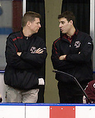 Bert Lenz (BC - Trainer), Mike Feeley (BC - Student Manager) - The Northeastern University Huskies defeated the Boston College Eagles 3-2 on Friday, February 19, 2010, at Matthews Arena in Boston, Massachusetts.