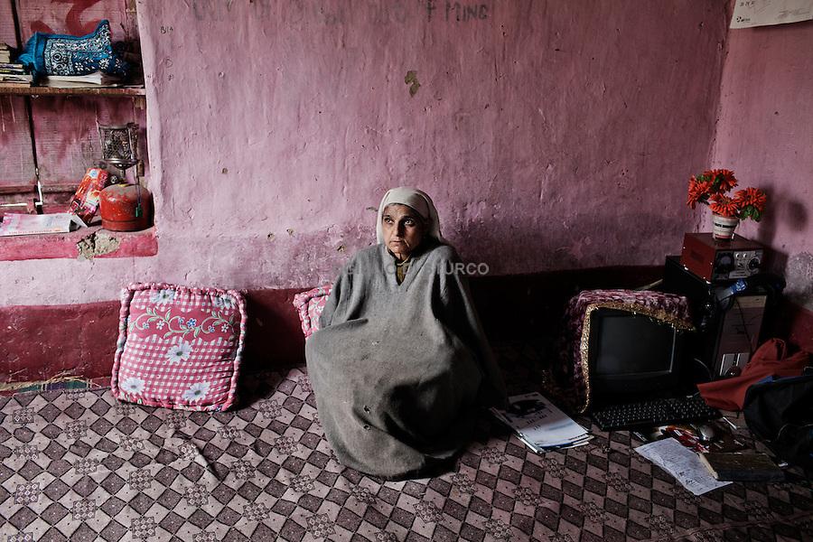 Raja ( 65 ), Half Widows..Abdul Raheem Rathore, he was 45 years old when he was kidnapped in his house ( 1995 ), Pattan, Kashmir 2011.