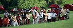 Thongchai Jaidee plays out of the rough on the first hole of his third round at the CIMB Asia Pacific Classic 2011.  Photo © Andy Jones / PSI for Carbon Worldwide