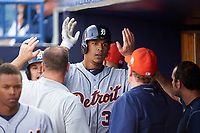 Detroit Tigers right fielder Steven Moya (33) high fives teammates after hitting a home run during a Spring Training game against the New York Yankees on March 2, 2016 at George M. Steinbrenner Field in Tampa, Florida.  New York defeated Detroit 10-9.  (Mike Janes/Four Seam Images)
