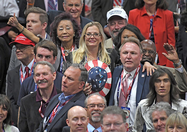 Convention delegates pose for a group photo during the Monday afternoon session of the 2016 Republican National Convention held at the Quicken Loans Arena in Cleveland, Ohio on Monday, July 18, 2016.<br /> Credit: Ron Sachs / CNP/MediaPunch<br /> (RESTRICTION: NO New York or New Jersey Newspapers or newspapers within a 75 mile radius of New York City)