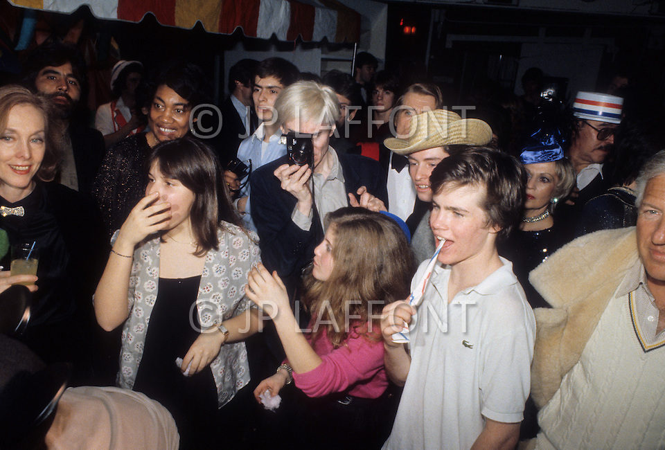 New York, circa 1975. Andy Warhol, the master of undergroung movies and pop art, seen at a party.