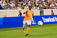 Boniek Garcia (27) of the Houston Dynamo. The New York Red Bulls defeated the Houston Dynamo 2-0 during a Major League Soccer (MLS) match at Red Bull Arena in Harrison, NJ, on August 10, 2012.