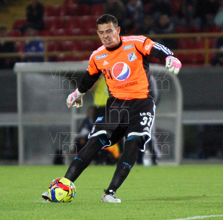 BOGOTA -COLOMBIA. 19-02-2014. Luis Delgado guardameta  de Millonarios  patea  el balon y convierte su gol  contra  el Once Caldas durante el partido por la sexta fecha de La liga Postobon 1 disputado en el estadio El Campin. /   Luis Delgado goalkeeper  of Millonarios kicks the ball and makes his goal against Once Caldas during the match for the sixth round of the league played one Postobon at El Campin stadium. Photo: VizzorImage/ Felipe Caicedo / Staff