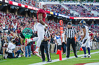 STANFORD, CA - NOVEMBER 23, 2013:  Francis Owusu celebrates a touchdown during Stanford's game against Cal. The Cardinal defeated the Bears 63-13.