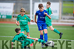 Kerrys Matthew Rogers makes a tackle for possession against Aaron McNamee of Waterford in the u13 Soccer league