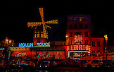 "While ""on tour"" with CSN in Europe, I got to hang out in Paris.  Wow.. What a city.  City of Lights.  The Moulin Rouge was lit up and was just waiting for this shot."