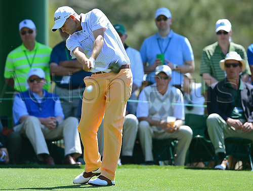 10.04.2014. Augusta, Georgia, USA.  Bill Haas follows through on his drive from the 18th tee during the first round of the Masters Tournament, Thursday, April 10, 2014, in Augusta, Ga