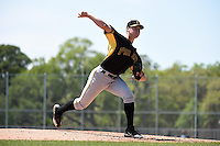 Pittsburgh Pirates pitcher Justin Topa (94) during a minor league spring training game against the New York Yankees on March 22, 2014 at Pirate City in Bradenton, Florida.  (Mike Janes/Four Seam Images)