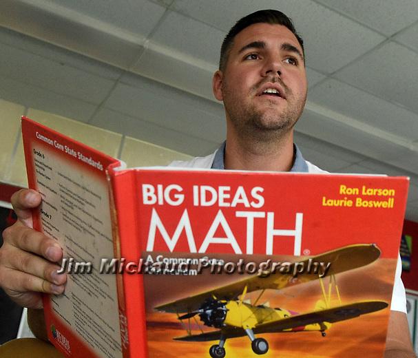 (09/18/17 Springfield MA)  Math teacher Evan Christensen in his classroom at John J. Duggan Academy, Monday, Sept. 18, 2017, in Springfield. Herald Photo by Jim Michaud