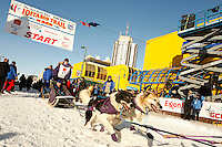 Jessie Royer leaves the start line during the Anchorage start day of  Iditarod 2009