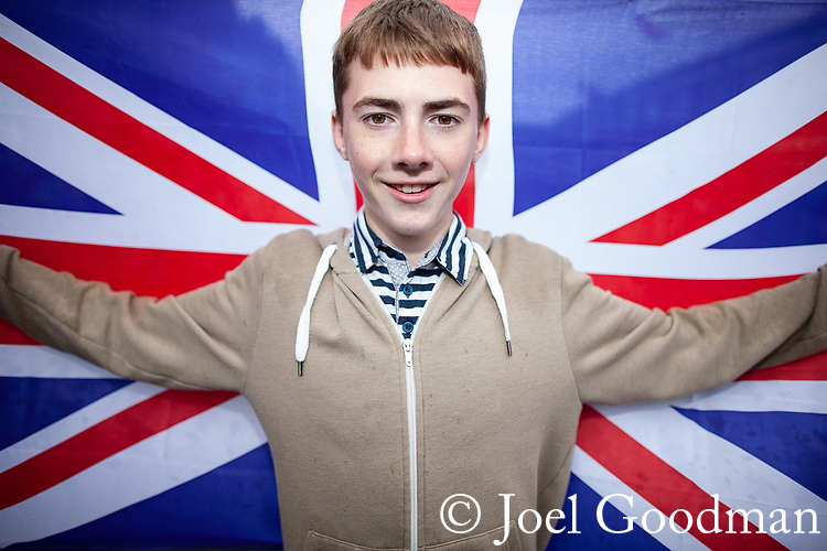 © Joel Goodman - 07973 332324 . 03/06/2012 . Manchester , UK . Lee Nuttall (correct) , 15 at a Jubilee party featuring the residents of Farnborough Road , Winstandley Road end , Miles Platting , as streets are closed for street parties for the Queen's Diamond Jubilee celebrations . Photo credit : Joel Goodman