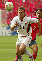 Brian McBride eyes the ball. The USA tied South Korea, 1-1, during the FIFA World Cup 2002 in Daegu, Korea.