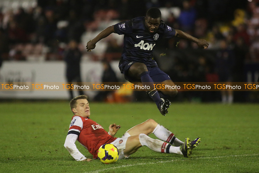 Larnell Cole of Manchester United leaps over an Arsenal tackle - Arsenal Under-21 vs Manchester United Under-21 - Barclays Under-21 Premier League Football at Meadow Park, Boreham Wood FC - 20/12/13 - MANDATORY CREDIT: Paul Dennis/TGSPHOTO - Self billing applies where appropriate - 0845 094 6026 - contact@tgsphoto.co.uk - NO UNPAID USE
