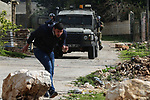 Israeli security forces fires tear gas at the Palestinian youth during clashes with Palestinian protesters following a weekly demonstration against the expropriation of Palestinian land by Israel in the village of Kfar Qaddum, near the West Bank city of Nablus on January 24, 2020. Photo by Shadi Jarar'ah