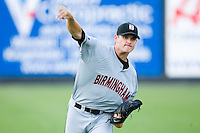 Kyle McCulloch #25 of the Birmingham Barons warms up in the outfield prior to pitching against the Carolina Mudcats at Five County Stadium August 15, 2009 in Zebulon, North Carolina. (Photo by Brian Westerholt / Four Seam Images)