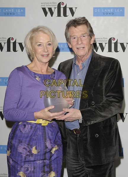 DAME HELEN MIRREN &amp; JOHN HURT <br /> At the De Lane Lea Women in Film &amp; Television Awards, Hilton Park Lane, London, England, UK, <br /> 4th December 2009.<br /> TV WFTV half length purple dress award trophy winner yellow waist belt floral flower print cardigan dress black velvet jacket suit shirt blue glasses <br /> CAP/CAN<br /> &copy;Can Nguyen/Capital Pictures