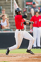 Tim Anderson (2) of the Kannapolis Intimidators follows through on his swing against the Greensboro Grasshoppers at CMC-Northeast Stadium on July 13, 2013 in Kannapolis, North Carolina.  The Intimidators defeated the Grasshoppers 7-5.   (Brian Westerholt/Four Seam Images)