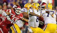11/14/15<br /> Arkansas Democrat-Gazette/STEPHEN B. THORNTON<br /> Arkansas' Deatrich Wise Jr. , left, moves in to pressure  LSU's QB Brandon Harris, leading to an incomplete pass  in the fourth quarter during their game Saturday in Baton Rouge, La.