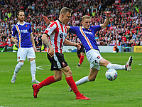 Lincoln City's Harry Anderson under pressure from Exeter City's Dean Moxey<br /> <br /> Photographer Andrew Vaughan/CameraSport<br /> <br /> The EFL Sky Bet League Two Play Off First Leg - Lincoln City v Exeter City - Saturday 12th May 2018 - Sincil Bank - Lincoln<br /> <br /> World Copyright &copy; 2018 CameraSport. All rights reserved. 43 Linden Ave. Countesthorpe. Leicester. England. LE8 5PG - Tel: +44 (0) 116 277 4147 - admin@camerasport.com - www.camerasport.com