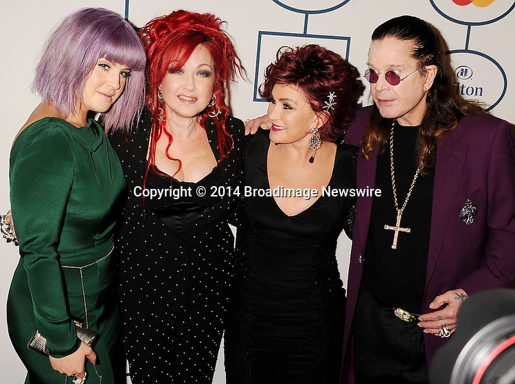 Pictured: Kelly Osbourne; Cindi Lauper; Sharon Osbourne;Ozzy Osbourne<br /> Mandatory Credit &copy; Joseph Gotfriedy/Broadimage<br /> The 56th Annual GRAMMY Awards - Pre-GRAMMY Gala And Salute To Industry Icons Honoring Lucian Grainge - Red Carpet<br /> <br /> 1/25/14, Beverly Hills, California, United States of America<br /> <br /> Broadimage Newswire<br /> Los Angeles 1+  (310) 301-1027<br /> New York      1+  (646) 827-9134<br /> sales@broadimage.com<br /> http://www.broadimage.com