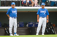 Team Korea head coach Seung-Ho Yang #80 and assistant coach Suk-Yeon Kim #71 at Knights Stadium July 16, 2010, in Fort Mill, South Carolina.  Photo by Brian Westerholt / Four Seam Images