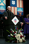 Michael Abdul-Malik Ryan, assistant director of the Office of Religious Diversity and chaplain, offers an invocation Saturday, June 10, 2017, during the DePaul University School for New Learning commencement ceremony at the Rosemont Theatre in Rosemont, IL. (DePaul University/Jeff Carrion)