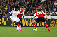 Pictured L-R: Wilfried Bony of Swansea against Craig Morgan of Rotherham. Tuesday 26 August 2014<br /> Re: Capital One Cup, Swansea City FC v Rotherham at the Liberty Stadium, south Wales