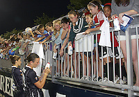 Abby Wambach #20 and Alex Singer #21 of the Washington Freedom sign autographs after a WPS match against the Chicago Red Stars at the Maryland Soccerplex, in Boyds Maryland on June 12 2010. The game ended in a 2-2 tie.
