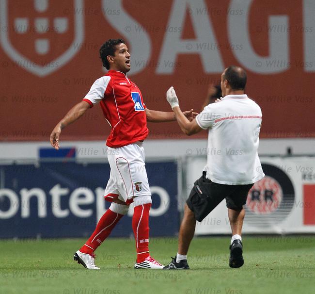 Mataeus celebrates his third Braga goal as the Braga trainer runs half the length of the field to join in