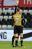 Jordan Rhodes of Sheffield Wednesday sees a yellow card by referee Stuart Attwell during The Emirates FA Cup Fifth Round Replay match between Swansea City and Sheffield Wednesday at the Liberty Stadium, Swansea, Wales, UK. Tuesday 27 February 2018
