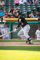 Kyle Parker (11) of the Albuquerque Isotopes at bat against the Salt Lake Bees in Pacific Coast League action at Smith's Ballpark on June 8, 2015 in Salt Lake City, Utah.  (Stephen Smith/Four Seam Images)