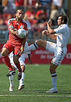 06 June 2009: Toronto FC midfielder Dewayne DeRosario #14 handles a ball from Los Angeles Galaxy midfielder Chris Klein #7 during  MLS action at BMO Field Toronto in a game between LA Galaxy and Toronto FC. .The Galaxy  won 2-1.
