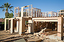 A large two-story wood frame house under construction in Cupertino, California, in Silicon Valley. Large amounts of wood and other raw materials are being used to build this new house on a lot where a single-story home was demolished.