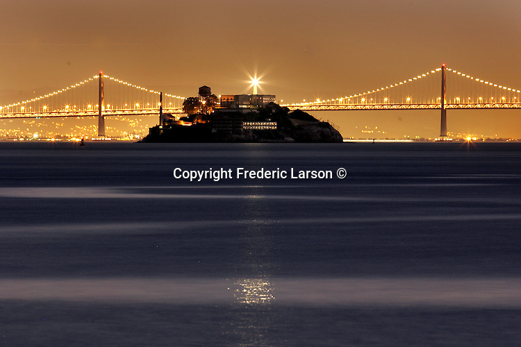 Alcatraz Island light house reflects a ray of light over the calm seas of the San Francisco Bay, California.