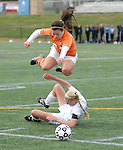 Danville High School soccer players hurdles over a Loyalsock player after a trip up