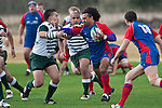 Sam Alatini tries to fend off the tackle of Sifa Lea. Sifa Lea .Counties Manukau Premier Club Rugby game between Ardmore Marist and Manurewa, played at Bruce Pulman Park, Papakura on Saturday July 18th 2009..Ardmore Marist won the game 32 - 5 after leading 10 - 5 at halftime.
